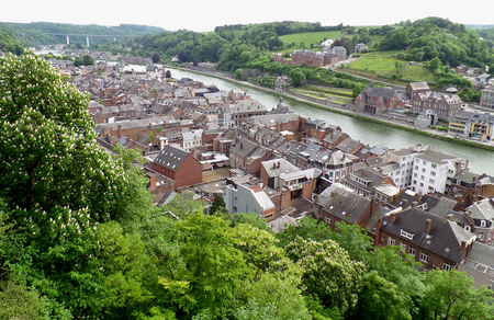 Impressive rooftop view of the vintage buildings along Meuse river, Dinant, Wallonia Region, Belgium Stock Photo