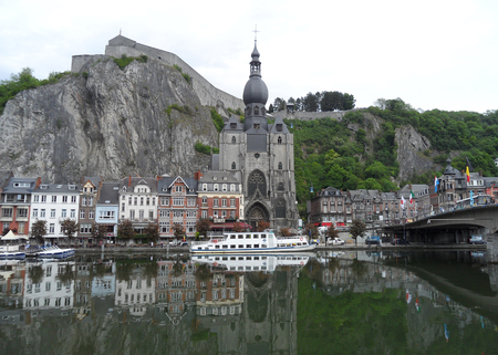 Reflections of gorgeous landmarks and architectures of Dinant on the Meuse river, Wallonia region, Belgium