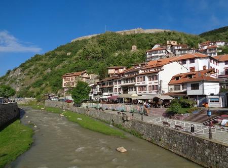 The Prizren Bistrica river flows through Prizren old city center in a beautiful sunny day, Kosovo