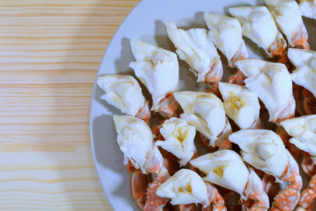 blue swimmer crab: Top View of Steamed Flower Crab Legs Served on Wooden Table