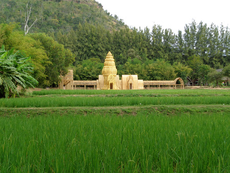 replica: Model of Khmer Temple Made from Loincloth on Vibrant Green Paddy Field, Nakhon Ratchasima province, Thailand Stock Photo