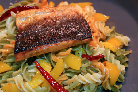 olio: Spiral shaped pasta with garlic, dried red chili, yellow pepper and olive oil topped with grilled Salmon