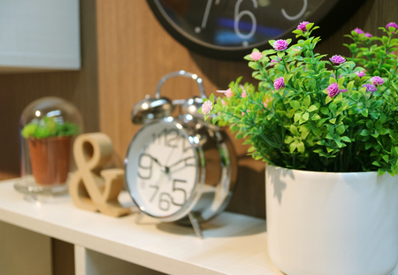 bedhead: Bedhead decoration with plants and clock with selective focus Stock Photo
