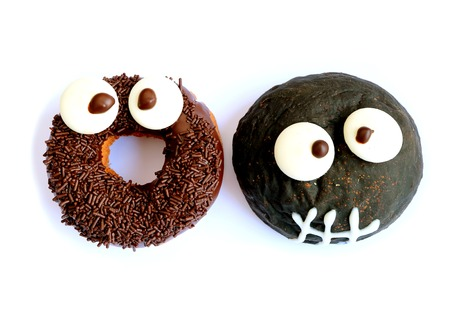 Monster Shaped Chocolate Doughnuts for Halloween Celebration Stock Photo