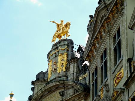 Gorgeous golden sculpture of Charles-Alexandre de Lorraine on the vintage building LArbre DOron at Grand Place in Brussels, Belgium
