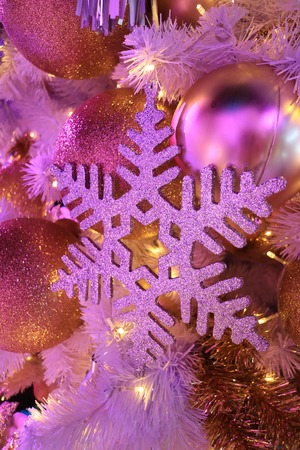 light up glitter snowflake and glitter ball shaped christmas ornaments in pink color light stock