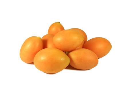 Heap of Vibrant Orange Yellow Fresh Ripe Marian Plum or Ma-Prang Fruits Isolated on White Background