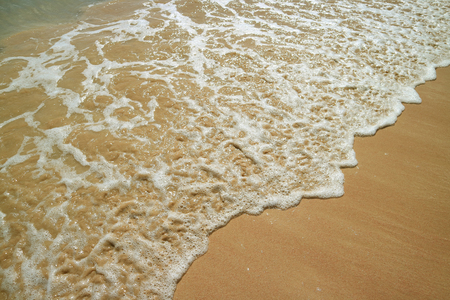 The Backwash and Sea Water Foam on Anakena Beach on Easter Island, Chile, South America