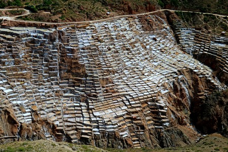 Incredible view of Salineras de Maras, the salt ponds nestled in a canyon of Sacred Valley, Cusco region, Peru Imagens