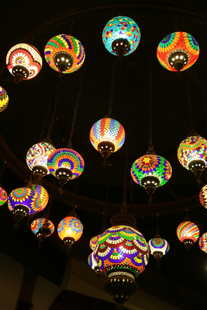Vertical Photo of Arabian Style Multi-color Hanging Mosaic Lamps in the Dark Room