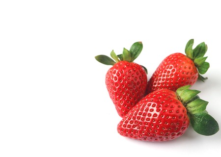 Three Bright Color Red Fresh Ripe Strawberries Isolated on White Background with Free Space for Design or Text Stok Fotoğraf