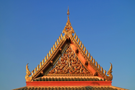 Beautiful Tympanum of Wat Khao Di Salak Buddhist Temple against Vibrant Blue Sky, Suphanburi Province, Thailand