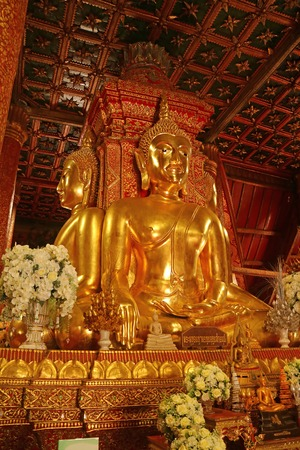 Vertical Photo of Golden Four-sided Seated Buddha Images in Wat Phumin Temple, Nan Province, Thailand