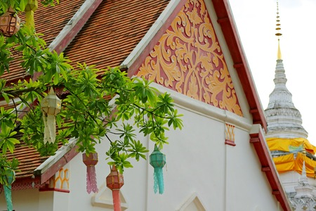 Decorated Tympanum and White Chedi (Stupa) of Wat Phra That Khao Noi Temple, Historic Place in Nan Province, Thailand