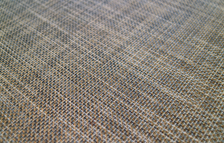 Closed up diagonal basket-weave pattern of a luncheon mat for background or banner