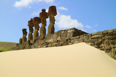 Seven gigantic Moai statues of Ahu Nau Nau ceremonial platform surrounded by soft coral sand of Anakena beach, Easter island, Chile