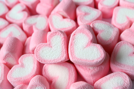 Closed Up a Pair of Pastel Pink and White Heart Shaped Marshmallow on the Pile of Same Candies Stock Photo - 115602879