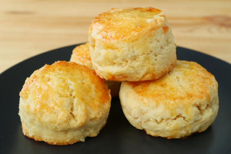 Closed Up Many of Mouthwatering Candied Orange Peel Scones on Black Plate Imagens