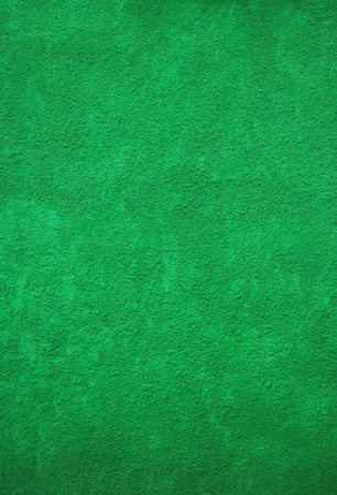 Vertical Image of Vivid Green Painted Rough Concrete wall for Background or Banner