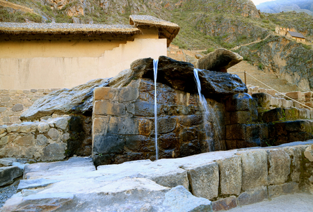 The Fountains of the Water Temple Still in the Original State of the Inca Empire, Ollantaytambo Fortress Ruins, Cusco, Peru Banco de Imagens