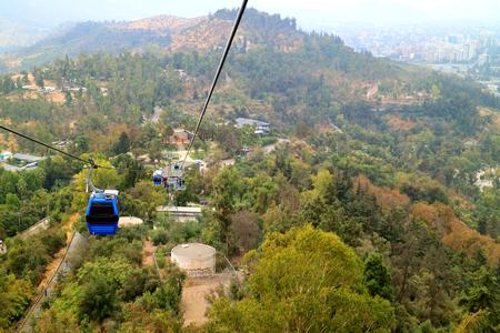 Cable Cars of Cerro San Cristobal Hill among Fall Foliage, Santiago, Chile