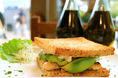 Closeup Grilled Chicken Breast and Avocado Sandwich