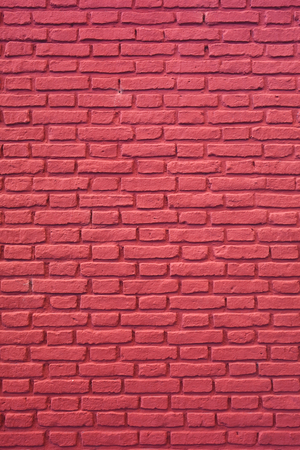 Vertical Image of Raspberry Red Colored Brick Wall for Background, Texture or Pattern Imagens