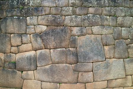 The Stone Wall with Unique Inca Stonework Inside Machu Picchu Ancient Citadel, Cusco, Urubamba, Archaeological site in Peru
