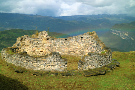 The remains of rounded house of Kuelap mountaintop fortified citadel with a rainbow in background, Archaeological site in Amazonas region. Peru Stok Fotoğraf
