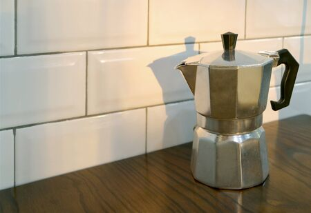 Moka Coffee Pot on Kitchen's Wooden Table with Copy Space