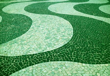 Green Colored Wave Patterned Mosaic Pavement for Background and Banner Stock Photo