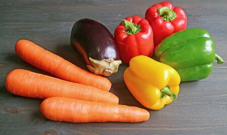Colorful fresh vegetables on dark brown wooden table Stock Photo