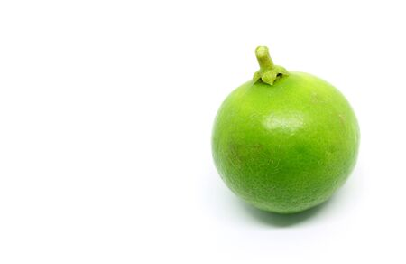 Closeup a vibrant green lime isolated on white background with copy space