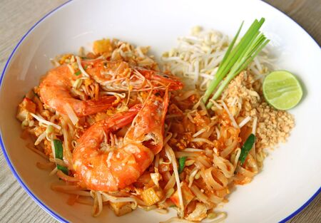 Closeup a Plate of Pad Thai or Thai Style Fried Noodle Topped with Prawns Stock Photo