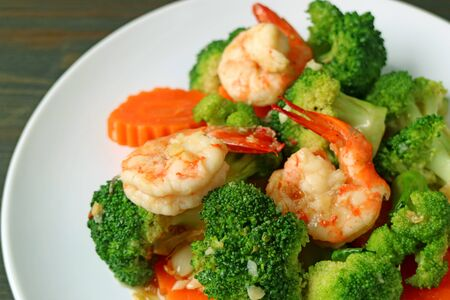 Closeup a plate of prawn stir fried with broccoli garlic and carrot Stock Photo