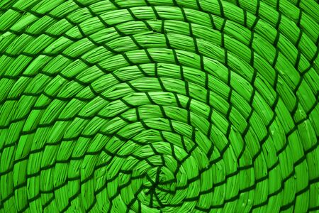 Abstract pattern of woven water hyacinth place mat in pop art styled neon green color