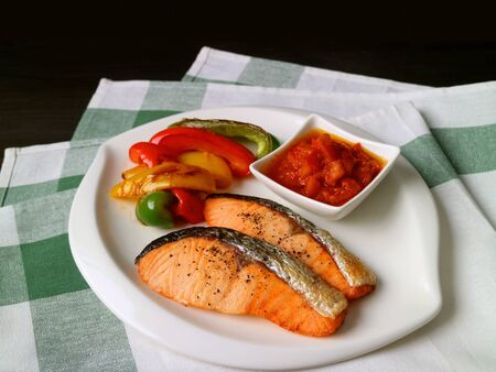 Plate of homemade grilled salmon steaks with colorful vegetables Stock Photo