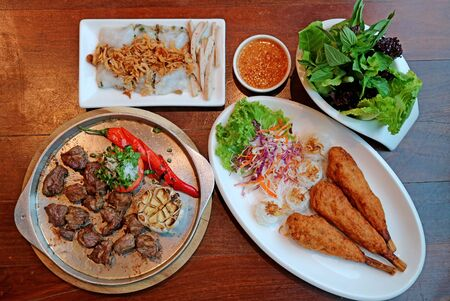 Top view of popular Vietnamese dishes on the wooden table Stock fotó