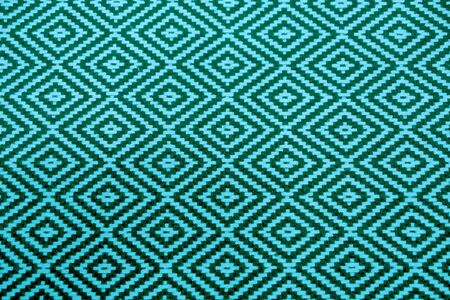 Vibrant and Deep Turquoise Blue Colored Ethnic Pattern Fabric for Background or Banner