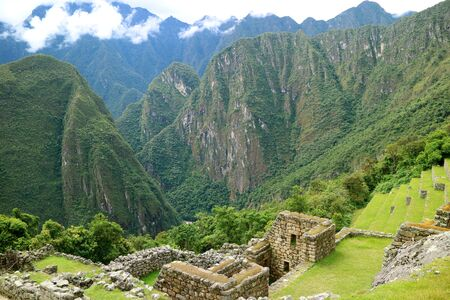 The Remains of Ancient Structures and Agricultural Terraces on the Mountain Slope of Machu Picchu Inca Citadel, Cusco Region, Peru