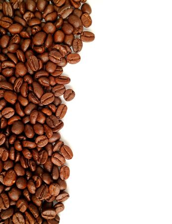 Vertical image of roasted coffee beans isolated on white background with free space for text or design