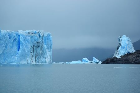 Giant Glacier Wall, ice mountain in the ocean in cloudy day