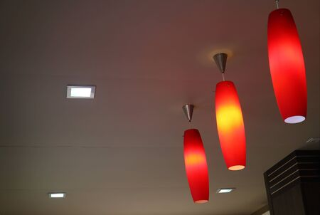 Set of vivid color ceiling pendant lampshades lighting up the warm light Stockfoto