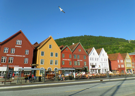 Bay Front Street along the Hanseatic Buildings of Bryggen with Many Visitors in Bergen, Norway
