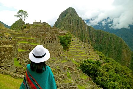 Female Visitor Being Impressed with the Amazing Machu Picchu Inca Citadel, Urubamba Province, Cusco Region, Peru 写真素材 - 129454967