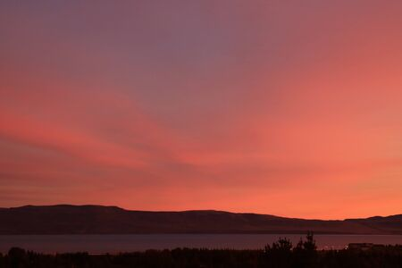 Beautiful pink and purple evening sky over the Lake Argentino, El Calafate, Patagonia, Argentina