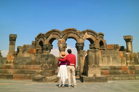 Couple Impressed by the Ancient Zvartnots Cathedral, Famous Ruins in Armavir Province, Armenia 版權商用圖片