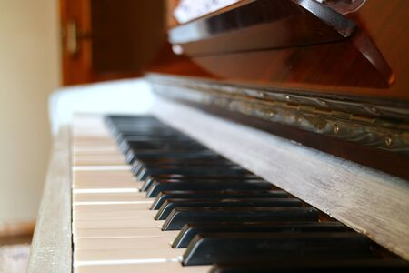 Side View of an Upright Pianos Keyboard with Blurry Background 写真素材