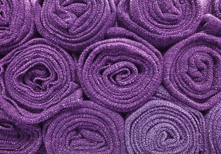 Pile of rolled up purple blankets for background or wallpaper Stock fotó