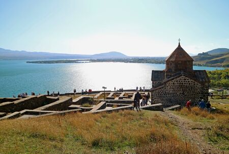Surb Arakelots or Church of the Holy Apostles Facing Lake Sevan, Sevanavank Monastery in Armenia Stock Photo